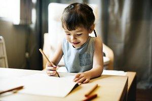 Young girl finishing her homework