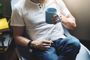 Bearded man with a coffee cup