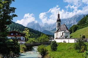 Scenic view of small white church against mountains