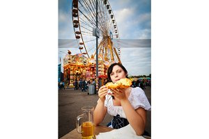 Young Woman Having A Snack At The Carnival