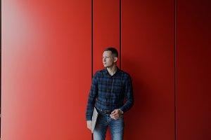 Designer on Red Modern Wall