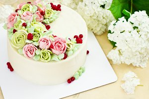 Birthday cake with flowers rose on light background