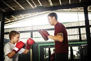 Young boy training boxing