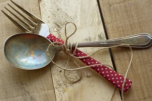 Vintage silverware on rustic wooden