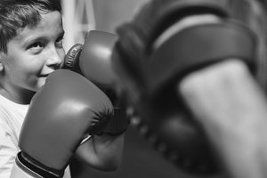 Young boy practice boxing