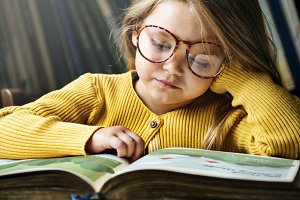 Adorable Cute Girl Reading