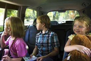 Siblings enjoying the car ride