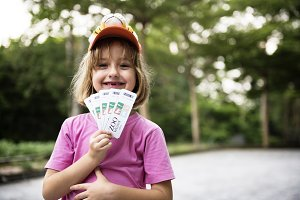 Girl showing zoo tickets