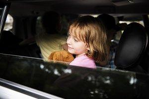 Girl sit inside the car