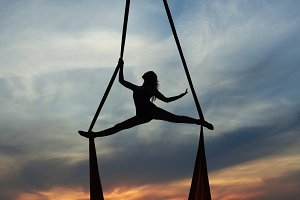 Woman balancing against the sky.