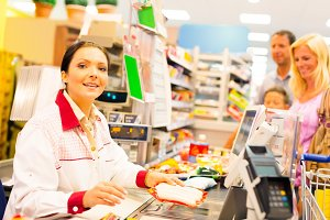 Sales Clerk In The Supermarket
