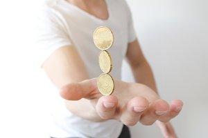 Balancing coins.