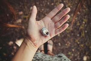 Girl holding shell in hand