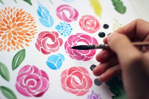 Girl drawing flowers with watercolor
