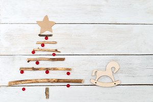 A wooden Christmas tree with berries