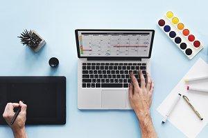 Hands using computer laptop