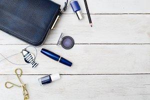 Dark blue handbag and blue make up