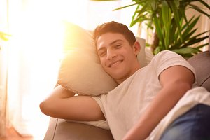 Man lying comfortably on couch