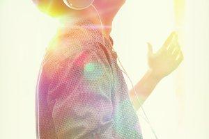 Profile teen listening music lights
