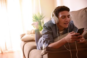Teenl with headphones listening