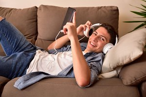 Teen on couch with headphones front