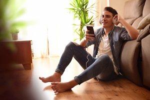 Teen listening music on the floor