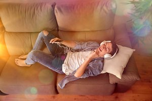 Teen dancing on couch top view