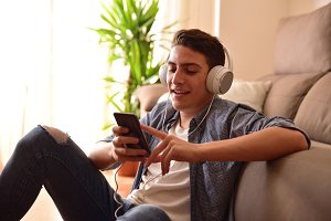 Teen sitting on floor using a mobile