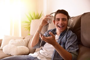 Teenager laughing with headphones
