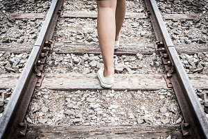 feet walking on railway