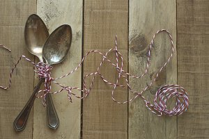 Vintage metal spoons on wooden table