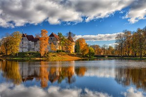 Ancient castle by the lake in autumn
