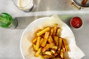 French fries, ketchup and beer