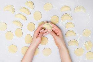 Woman's hands make ravioli