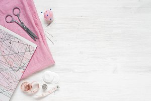 Pink fabric and sewing tools