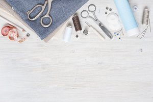 Blue fabric and sewing tools