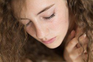 Teenage girl lying on a bed