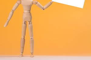 wooden manikin and space for text