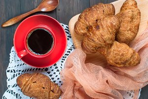 Cup coffee and croissants