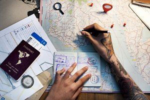 Aerial of hands planning to travel