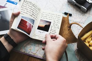 hands holding journey diary notebook