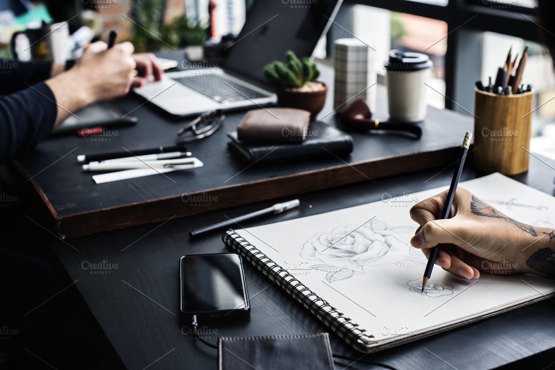 d260f75a8 Closeup of tattooed hand drawing ~ Business Photos ~ Creative Market