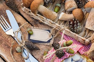 Raw white mushrooms, pine cones and decorative tag