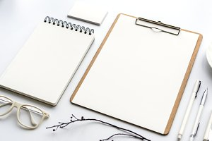 notebook and paper isolated on white