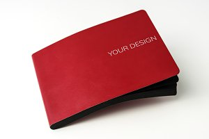 Red cover notebook on white table