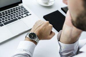Closeup of man checking time