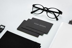 Black paper cards with eyeglasses