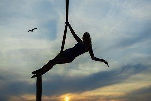 Aerial acrobat against the sky.
