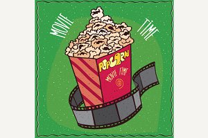 Cardboard box with popcorn and reel of film