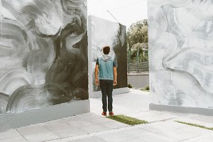 Man Looking on Street Art Space